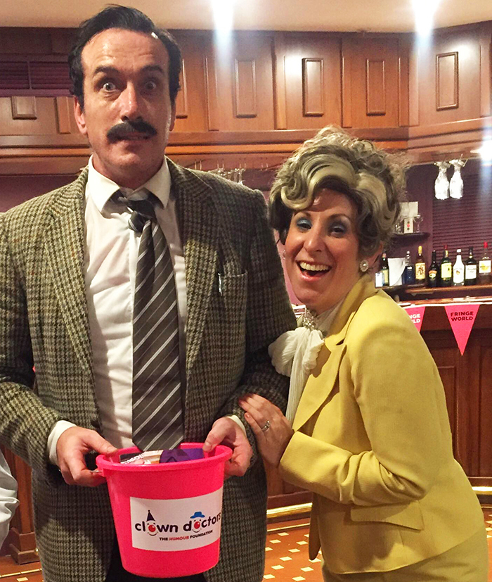 Luke McGibney and Rhian McLean with Clown Doctors collection bucket