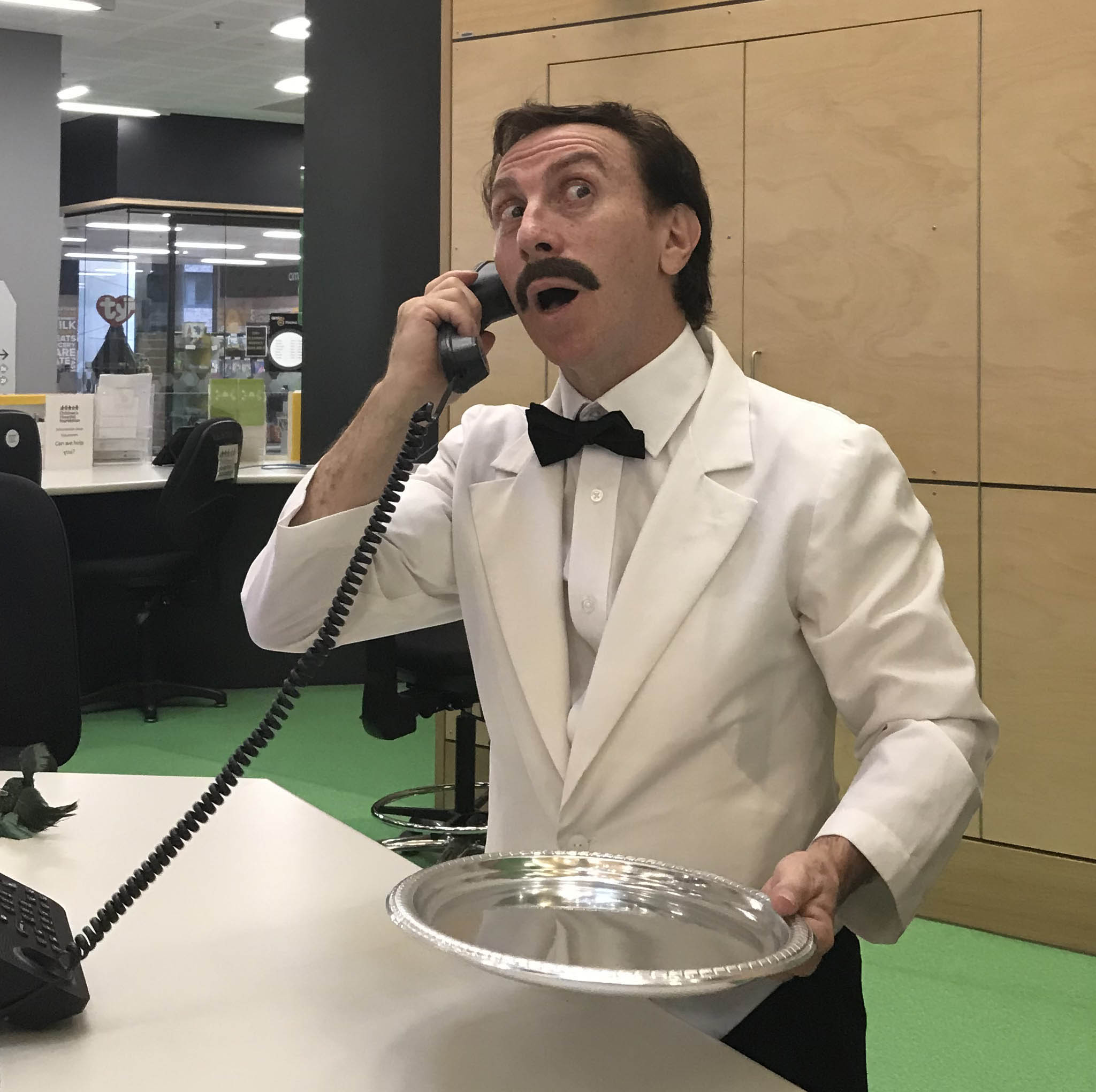 Andy Foreman dressed as Manuel on phone
